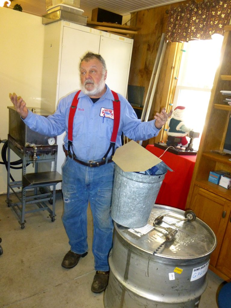 """I'm old school"", Rob exclaims showing the old-fashioned sap collection buckets"