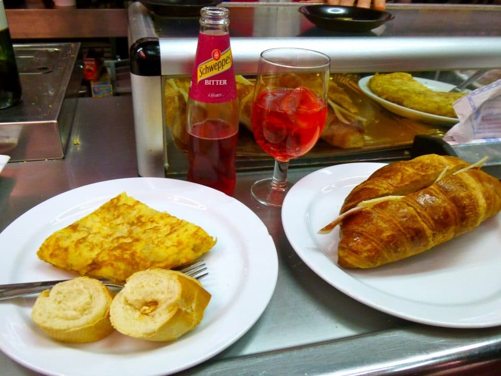 "Spanish tortilla and Ham and Cheese Croissant with ""bitters without alcohol"" at Museo de Jamon.  Photo courtesy of Katie Foote."